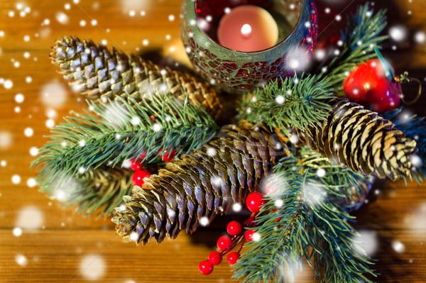 Karácsony fenyő ág dekoráció gyertya lámpás Stock fotó © dolgachov