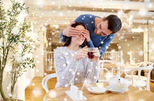 happy couple drinking tea at cafe Stock photo © dolgachov