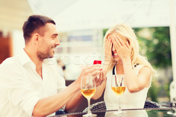 happy couple with engagement ring and wine at cafe Stock photo © dolgachov