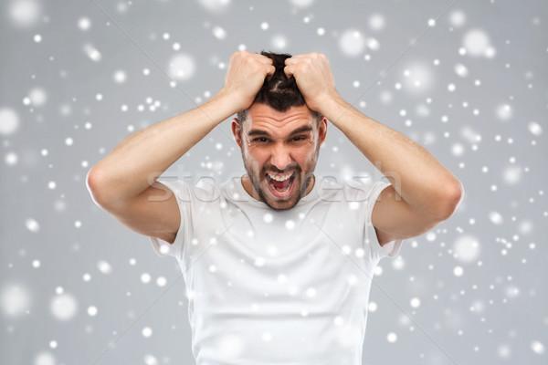 Loco hombre camiseta nieve emociones Foto stock © dolgachov