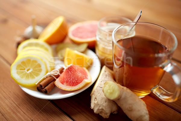 Jengibre té miel agrios canela madera Foto stock © dolgachov