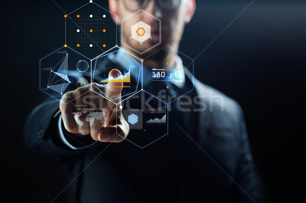 close up of businessman with virtual charts Stock photo © dolgachov