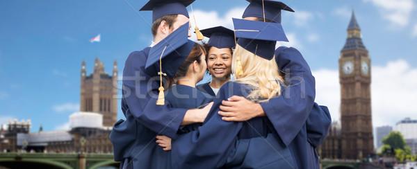 Foto stock: Feliz · estudantes · solteiros · educação · graduação