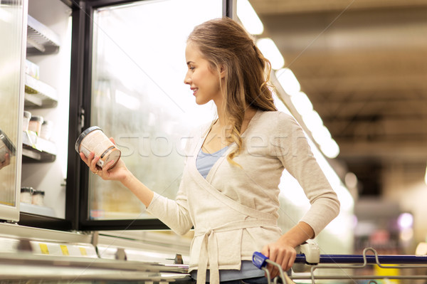 woman with ice cream at grocery store freezer Stock photo © dolgachov