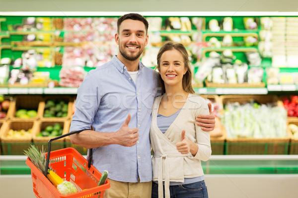 Feliz casal comida cesta mercearia compras Foto stock © dolgachov