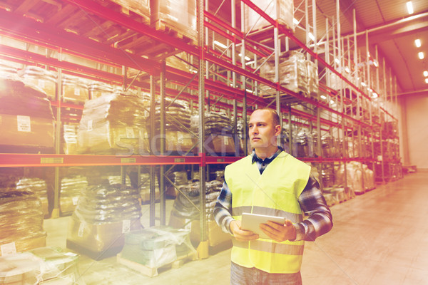 manual worker with tablet pc at warehouse Stock photo © dolgachov