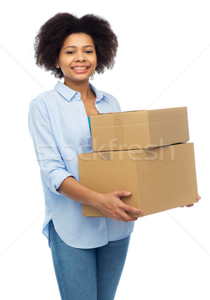 happy african young woman with parcel boxes Stock photo © dolgachov