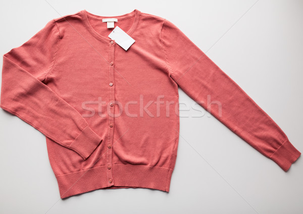 cardigan with price tag on white background Stock photo © dolgachov