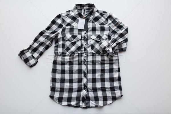 checkered shirt with price tag on white background Stock photo © dolgachov