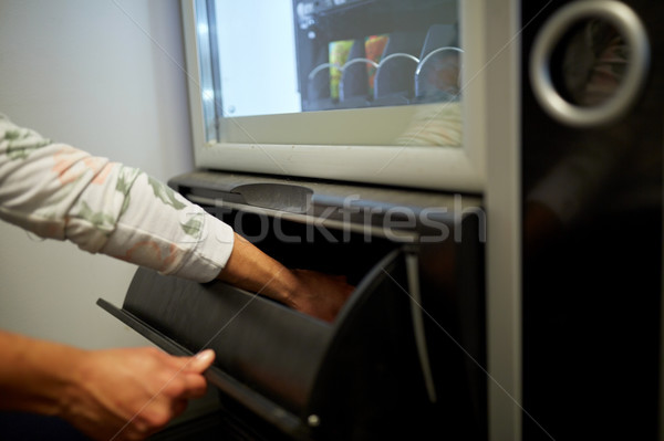 hand taking purchase from vending machine Stock photo © dolgachov