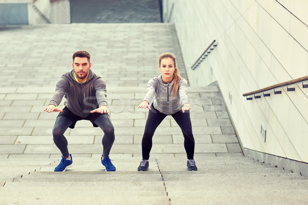 couple doing squats and exercising outdoors Stock photo © dolgachov