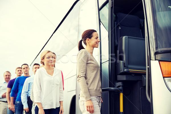 Csoport boldog utasok beszállás utazás busz Stock fotó © dolgachov