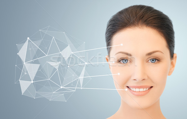 woman face with low poly projection and pointers Stock photo © dolgachov