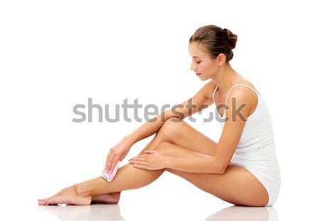 woman with epilator removing hair on legs Stock photo © dolgachov