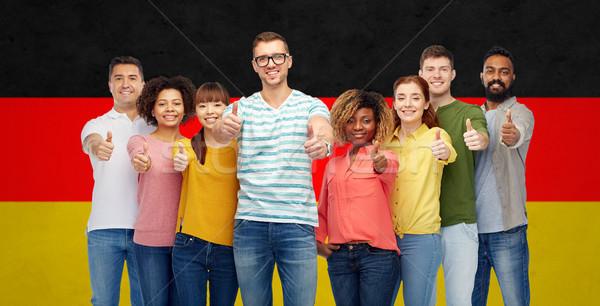 Mutlu insanlar bayrak çeşitlilik yarış Stok fotoğraf © dolgachov