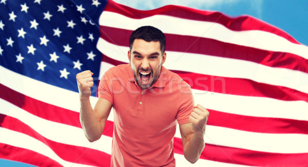 angry man showing fists over american flag Stock photo © dolgachov