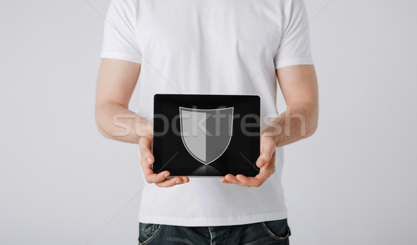 man with antivirus program icon on tablet pc Stock photo © dolgachov