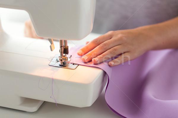 sewing machine presser foot stitching fabric Stock photo © dolgachov