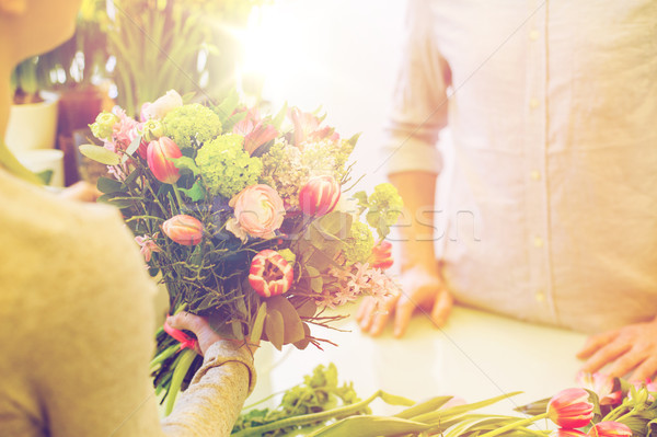 close up of florist woman and man at flower shop Stock photo © dolgachov