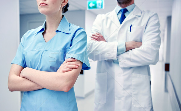 close up of doctor and nurse at hospital corridor Stock photo © dolgachov