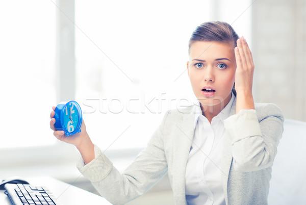 stressed businesswoman holding clock Stock photo © dolgachov