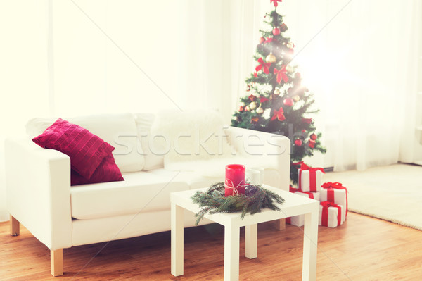 sofa, table and christmas tree with gifts at home Stock photo © dolgachov