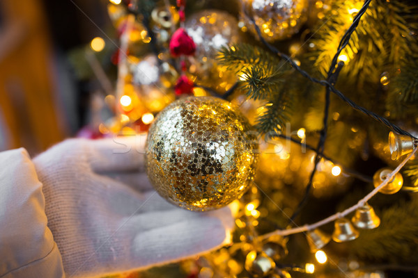 close up of hand with christmas tree toy Stock photo © dolgachov