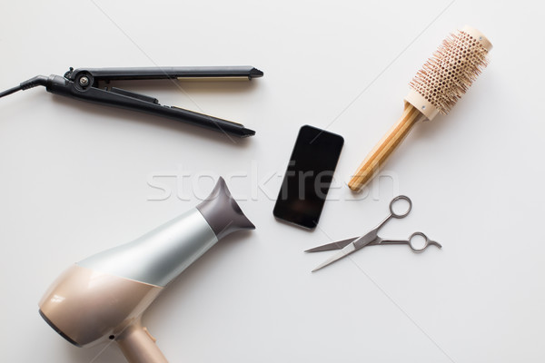 smartphone, scissors, hairdryer, iron and brush Stock photo © dolgachov