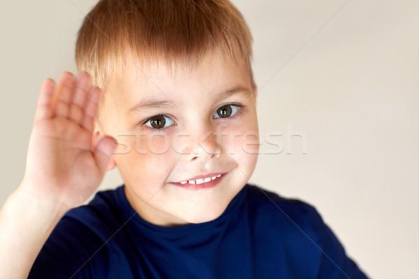 portrait of happy smiling little boy waving hand Stock photo © dolgachov