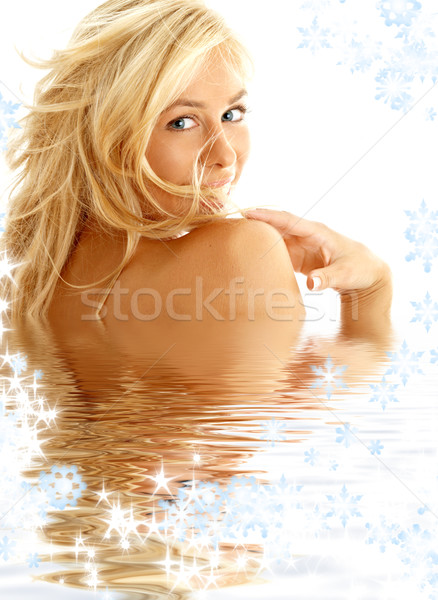 happy blond in water with snowflakes Stock photo © dolgachov