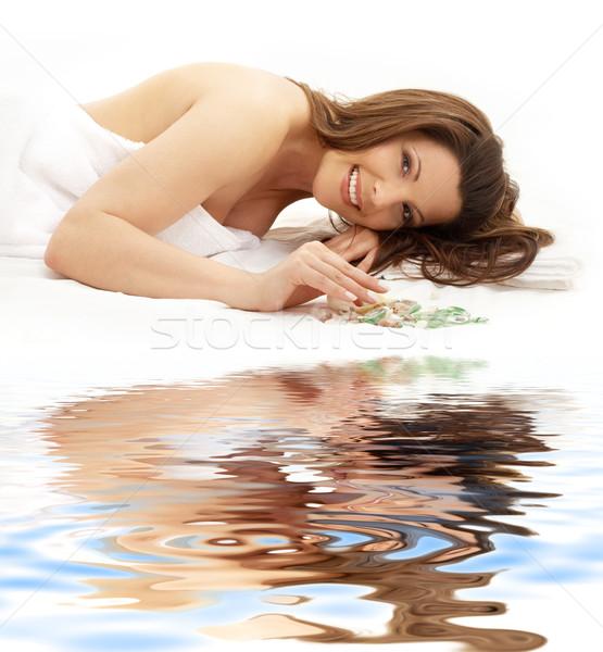 happy brunette on white sand Stock photo © dolgachov