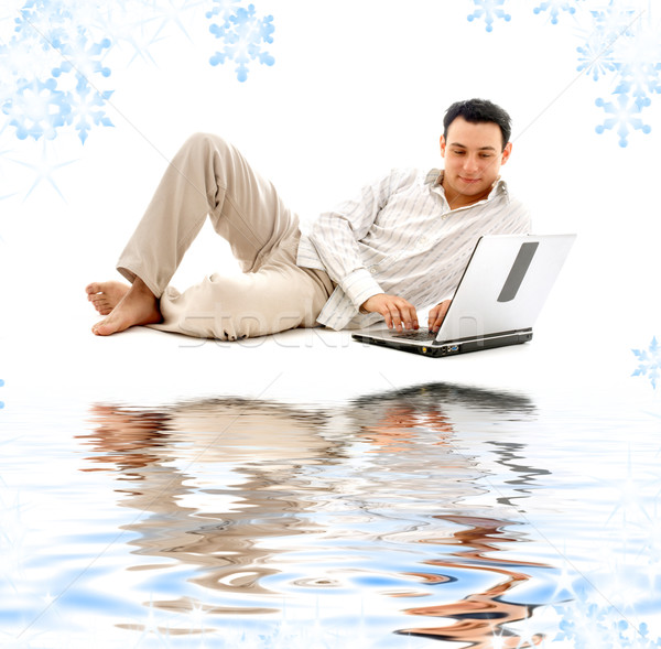 relaxed man with laptop on white sand Stock photo © dolgachov