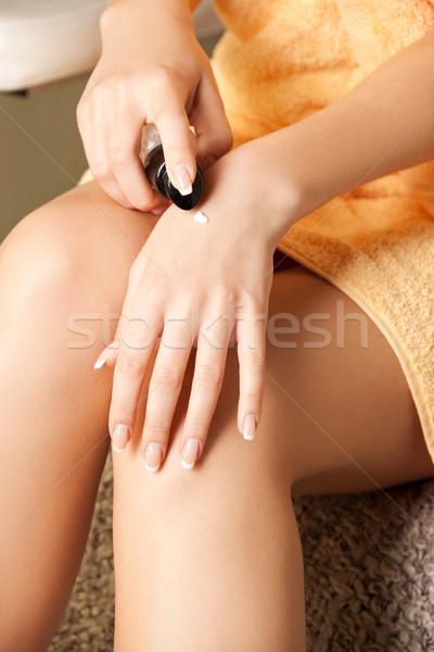 woman applying skin creme to hands Stock photo © dolgachov