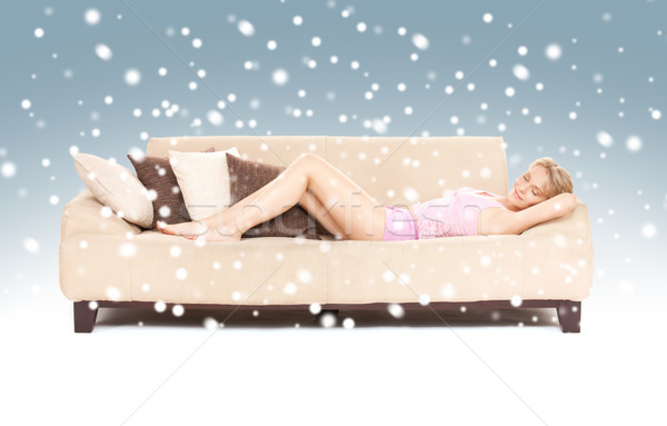 sleeping woman on sofa with snow Stock photo © dolgachov