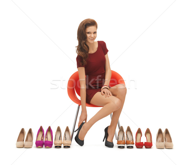 Stock photo: woman trying on high heeled shoes