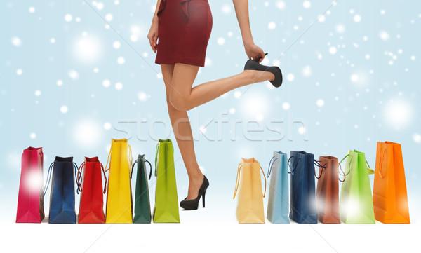 Hosszú lábak bevásárlótáskák vásárlás vásár ajándékok karácsony Stock fotó © dolgachov