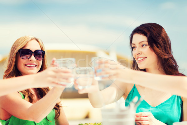 girls making a toast in cafe on the beach Stock photo © dolgachov