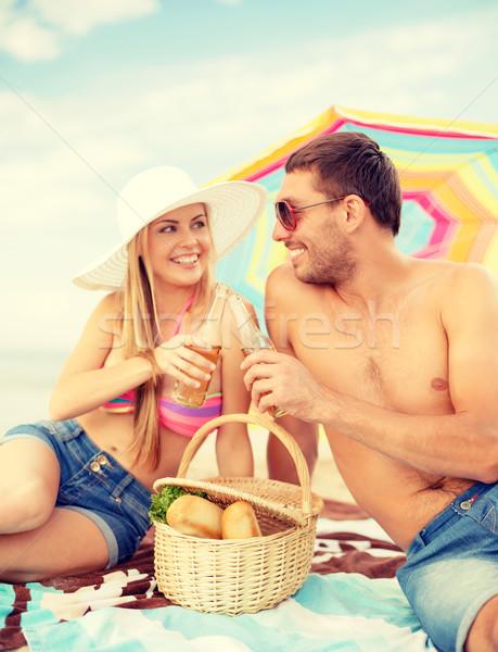 Sorridere Coppia picnic spiaggia estate vacanze Foto d'archivio © dolgachov