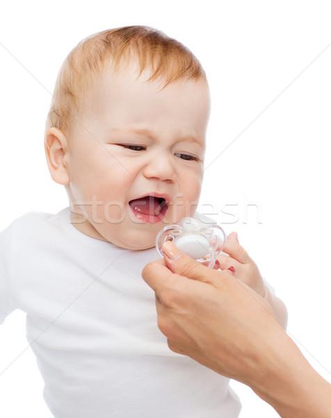 crying baby with dummy Stock photo © dolgachov