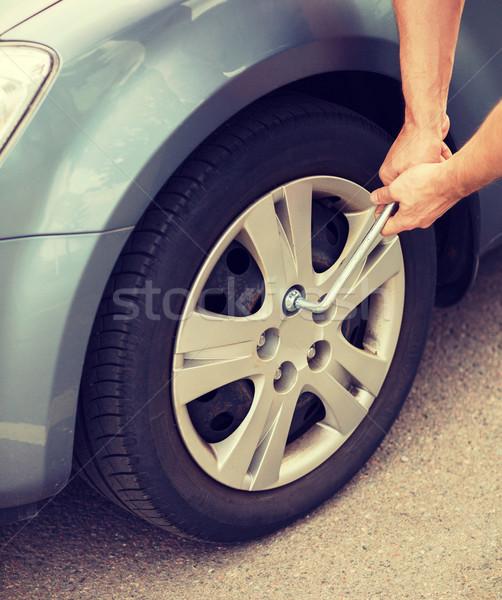 man changing tire Stock photo © dolgachov