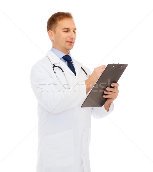 smiling male doctor with clipboard and stethoscope Stock photo © dolgachov