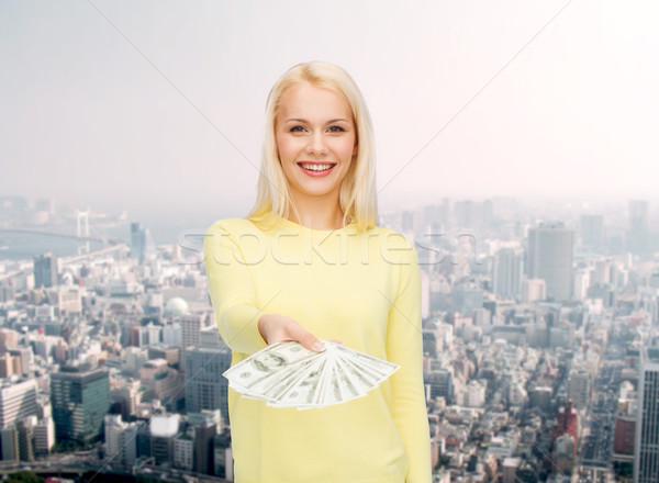 Gülen kız dolar nakit para Stok fotoğraf © dolgachov