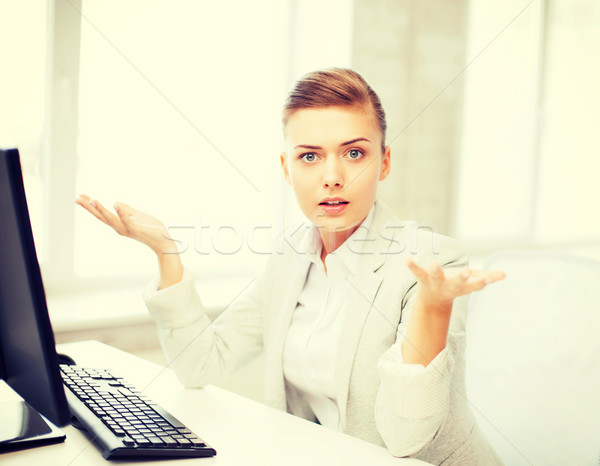 stressed businesswoman with computer Stock photo © dolgachov