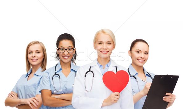 Stok fotoğraf: Gülen · kadın · doktor · kırmızı · kalp