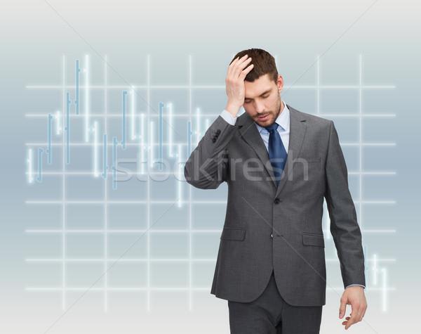 handsome businessman having headache Stock photo © dolgachov