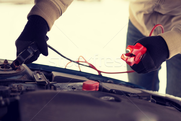 closeup of man under bonnet with starter cables Stock photo © dolgachov