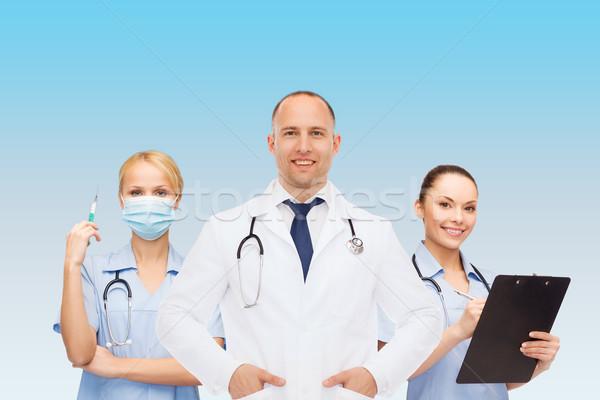 グループ 笑みを浮かべて 医師 クリップボード 薬 職業 ストックフォト © dolgachov