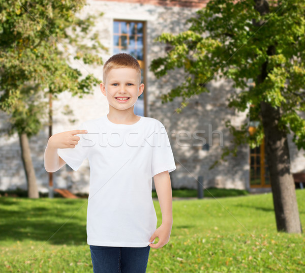 smiling little boy in white blank t-shirt Stock photo © dolgachov