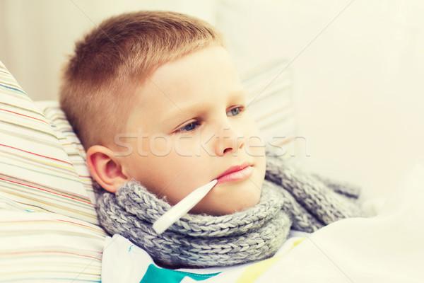 Malade garçon grippe maison enfance santé Photo stock © dolgachov