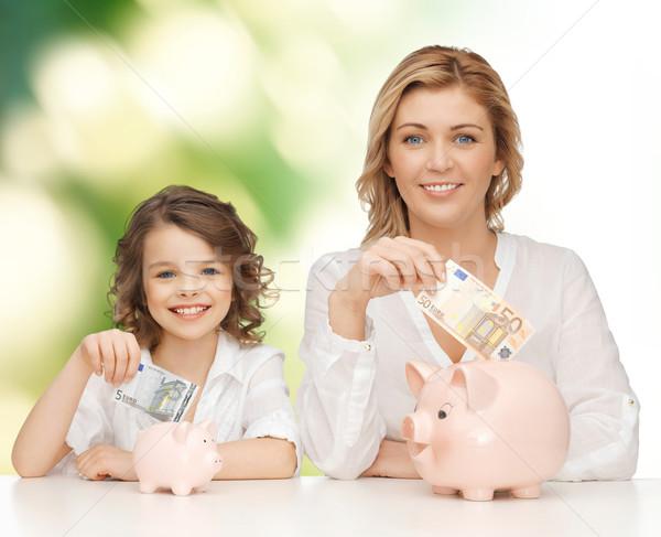 Moeder dochter geld banken mensen Stockfoto © dolgachov